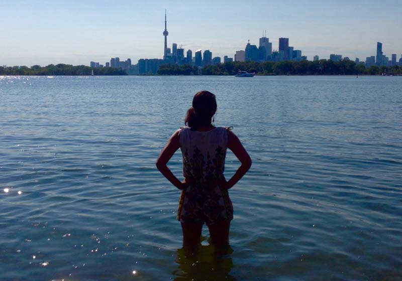 Maya standing in Toronto's Outer Harbour
